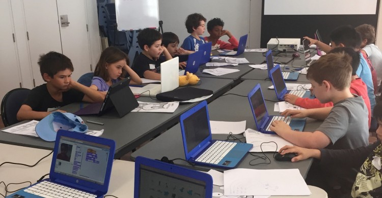 Image of Children Learning to Code Programming in a Classroom